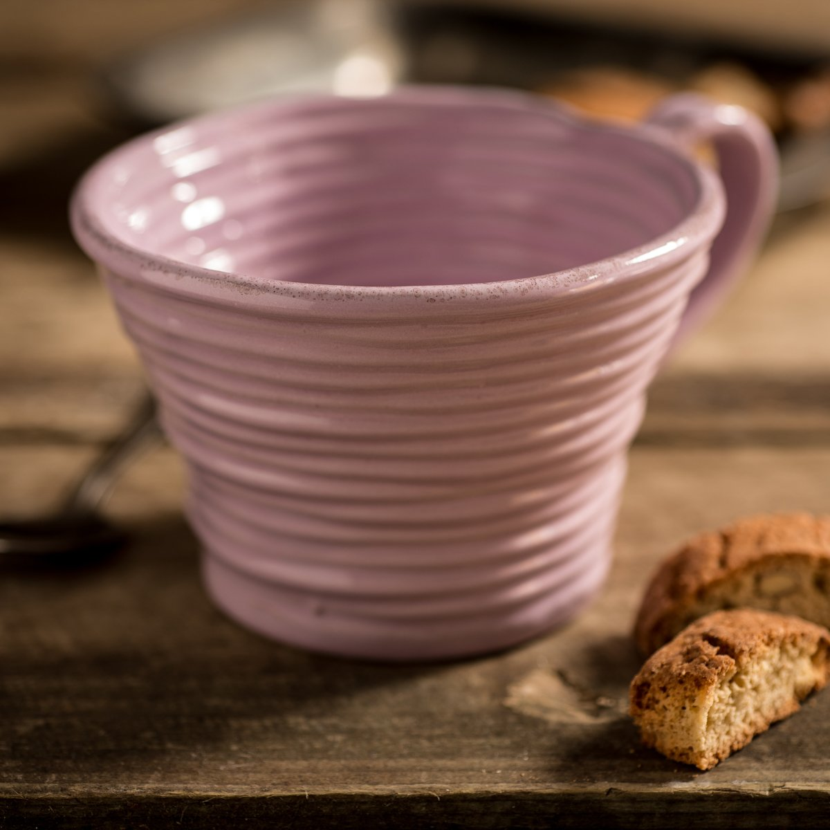 Hand-coiled artisan mug in pink by Ceramiche Tapinassi