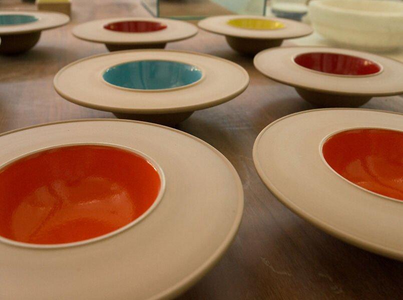 Brightly coloured ceramic dishes by Ceramiche Bucci