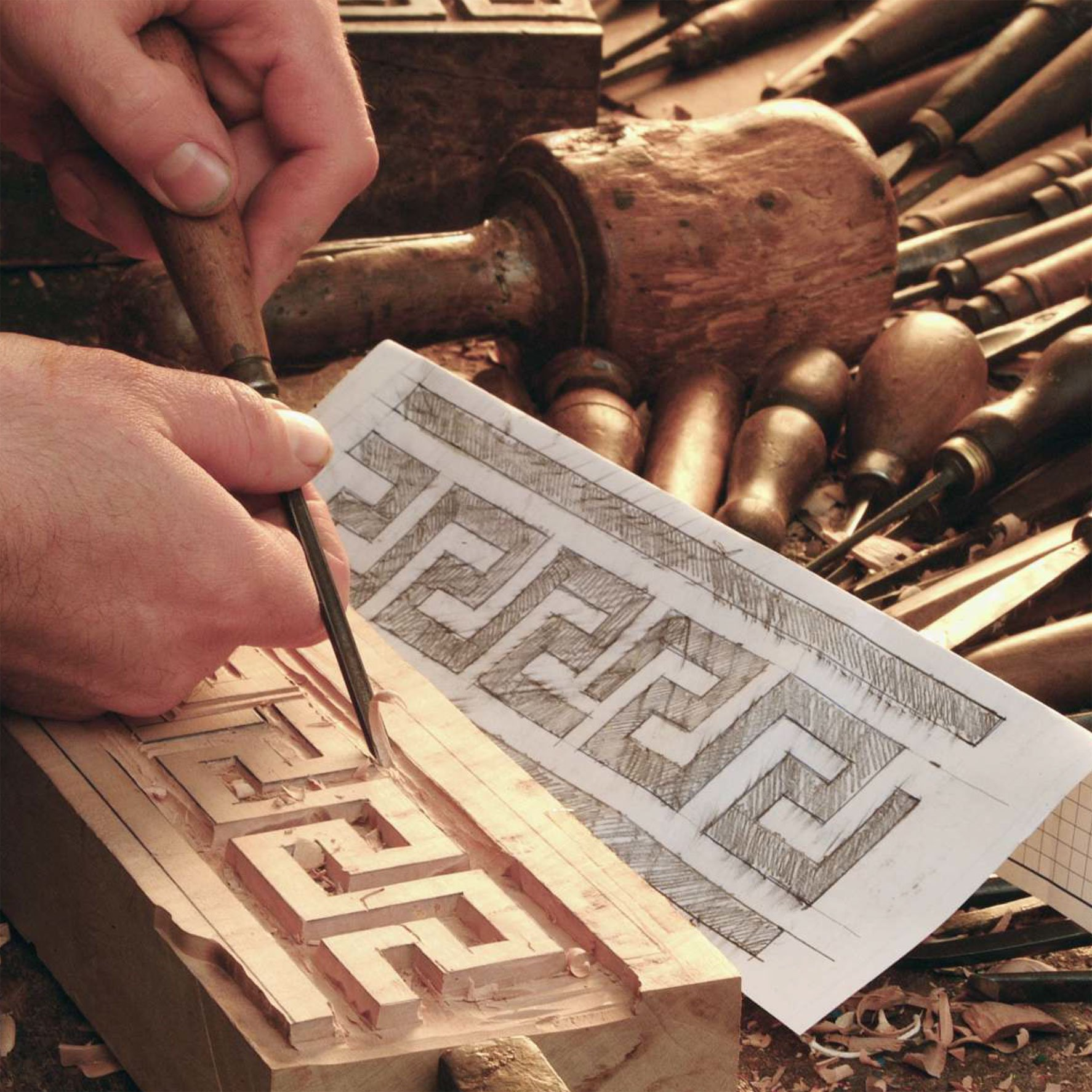 Hand-carving a wooden block for stamping