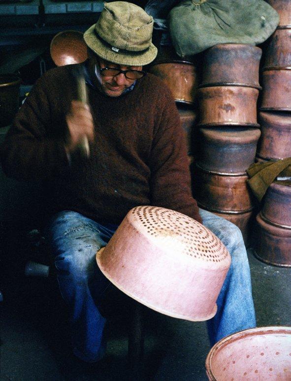 Hammering a copper pan