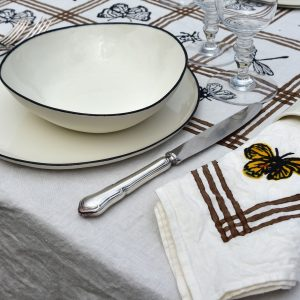 spring tablescape with Inspired by spring, the beautiful handprinted butterfly rests, as if in a watercolour painting, upon the finished organic napkin.