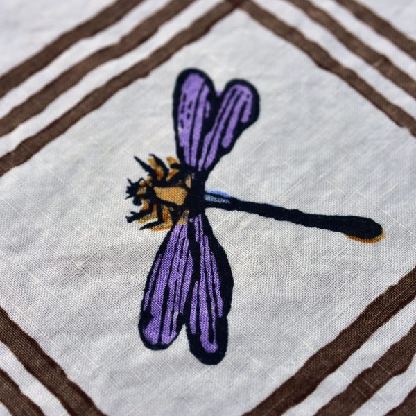 close up of Delicate Dragonfly hand printed motif on napkin
