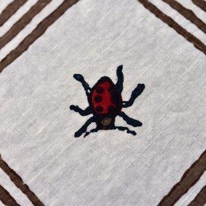 handprinted ladybird motif on organic linen napkin