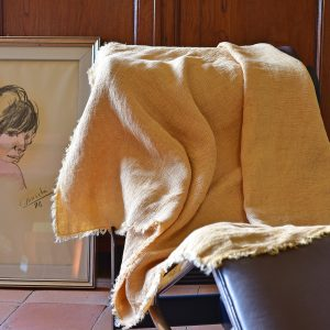 Waffle Throw - Hand-painted Linen Throw - Mustard - Throw draped over indoor chair