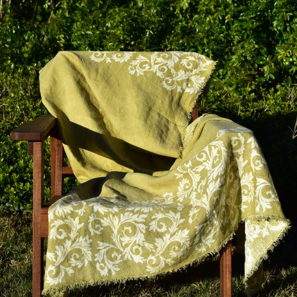 Linen Throw - Hand-painted and Hand-printed - Acanthus Leaves/Lime Green - Placed over outdoor chair