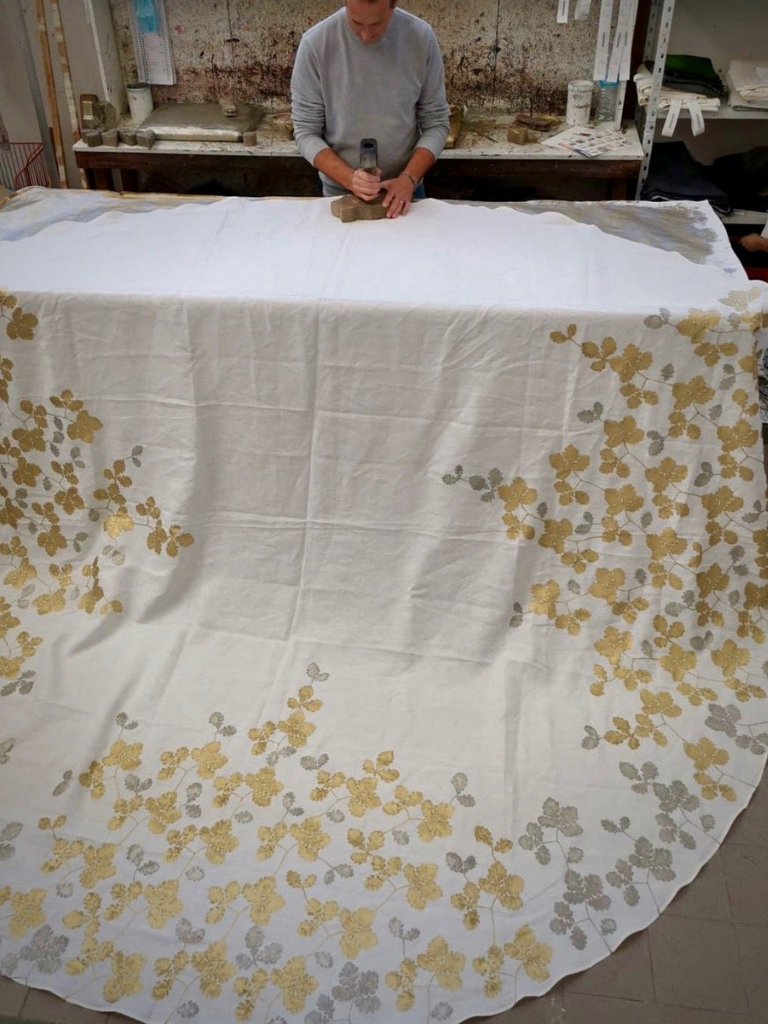 Bespoke linen tablecloth in the process of being hand-printed to create a Rovere design